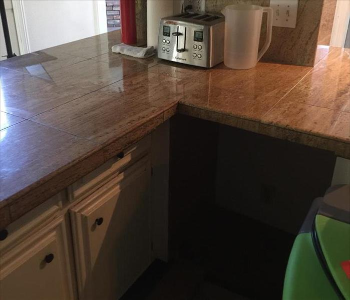 Saved marble top in ornate Los Angeles kitchen water damage. Before