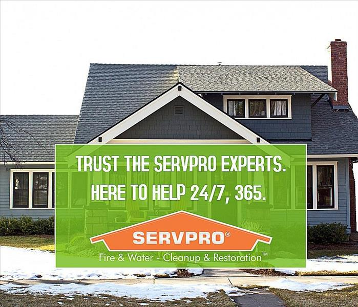 SERVPRO logo and information in front of house