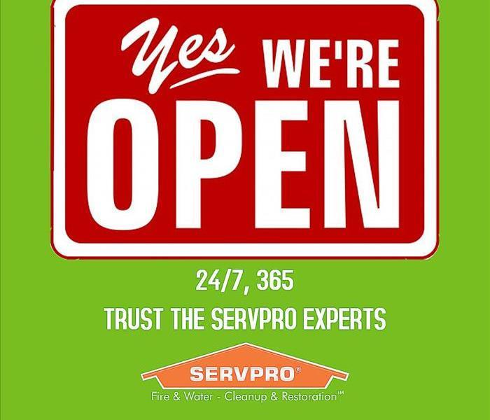 An open sign with the SERVPRO hours, 24/7, 365!